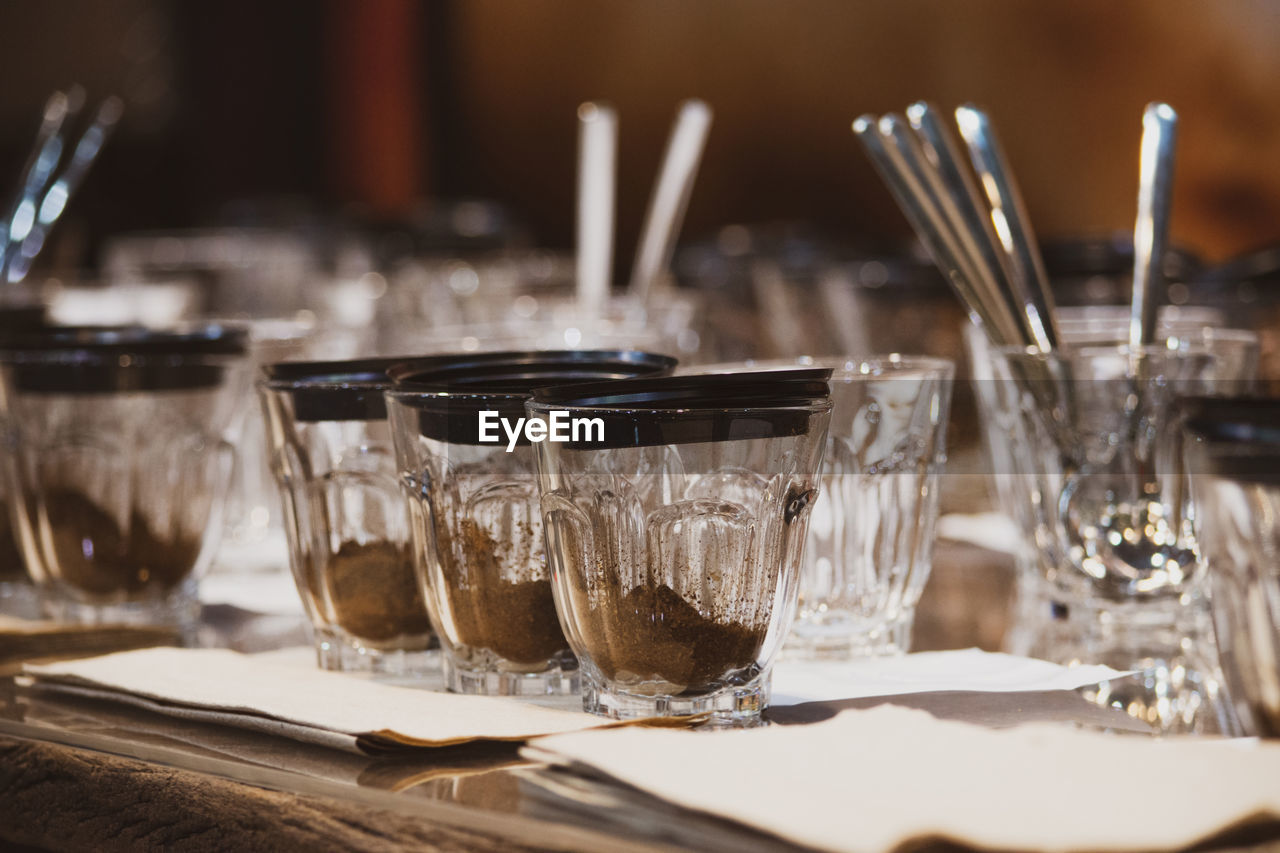 table, food and drink, glass, household equipment, drinking glass, drink, indoors, close-up, eating utensil, refreshment, focus on foreground, no people, transparent, kitchen utensil, glass - material, still life, food, fork, restaurant, freshness