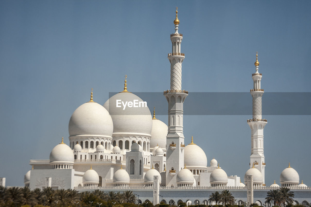 Low angle view of grand mosque against clear sky