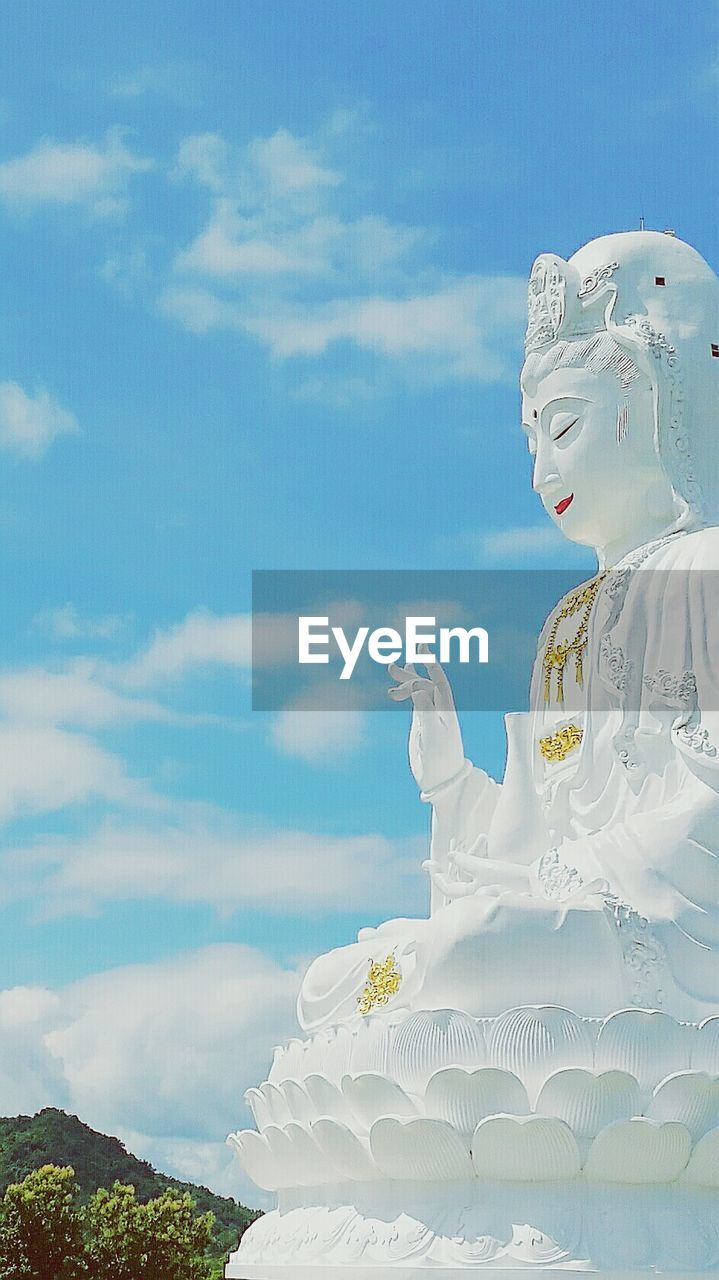 sky, religion, sculpture, statue, spirituality, human representation, low angle view, cloud - sky, idol, no people, day, outdoors