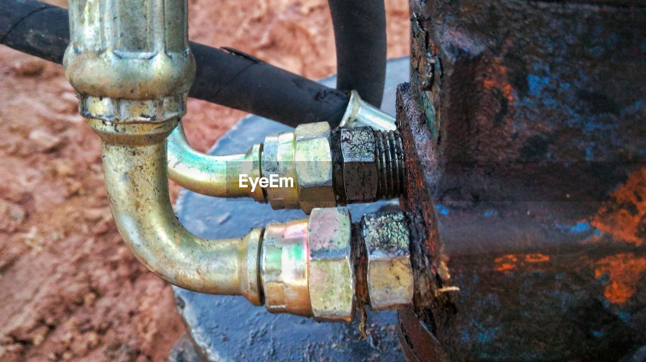 metal, rusty, day, close-up, abandoned, weathered, outdoors, old, machinery, focus on foreground, obsolete, decline, deterioration, nature, industry, fuel and power generation, run-down, pipe - tube, connection, no people