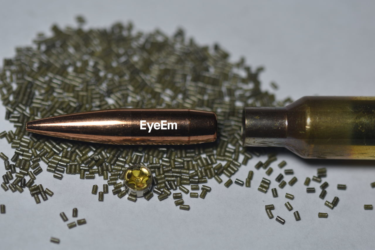close-up, gold colored, no people, bullet, indoors, day