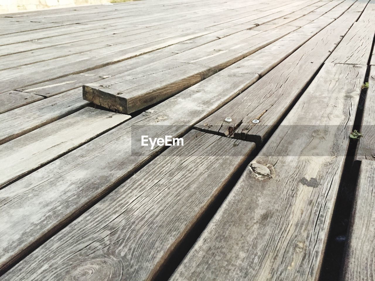 wood - material, high angle view, no people, day, plank, metal, close-up, wood, textured, pattern, nail, work tool, tool, sunlight, bench, outdoors, carpentry, hammer, boardwalk, hand tool, wood grain