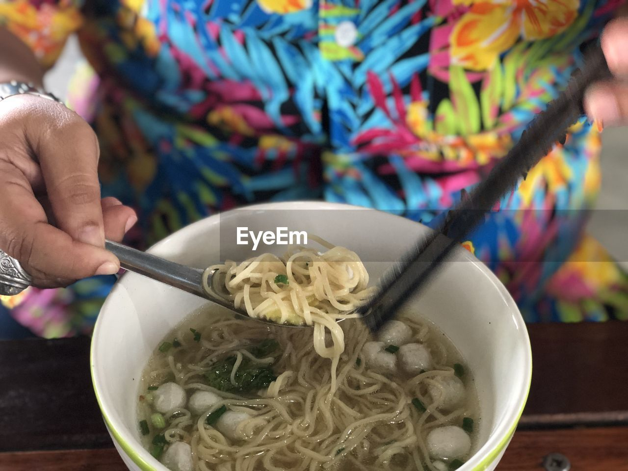 human hand, food, food and drink, hand, holding, human body part, bowl, real people, pasta, one person, freshness, kitchen utensil, italian food, spoon, healthy eating, eating utensil, indoors, table, unrecognizable person, wellbeing, body part, finger, noodle soup, spaghetti, mixing