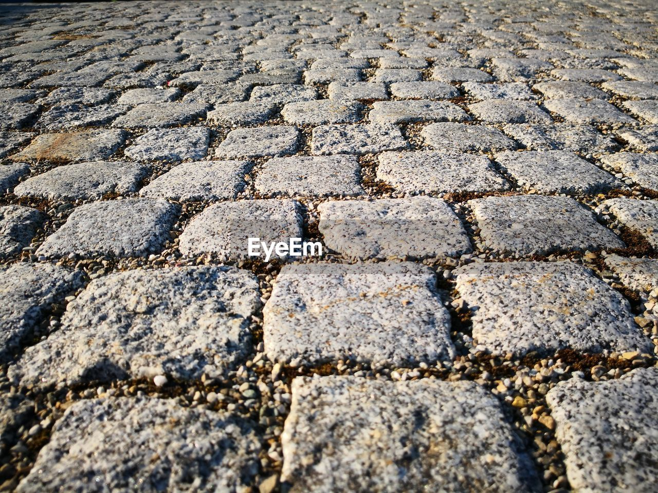 backgrounds, full frame, textured, no people, street, pattern, footpath, cobblestone, rough, city, day, outdoors, stone, solid, architecture, stone material, paving stone, nature, in a row, high angle view, surface level, concrete, textured effect