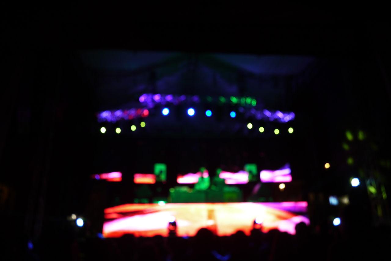 illuminated, night, arts culture and entertainment, nightlife, music, stage - performance space, stage light, performance, popular music concert, spotlight, indoors, defocused, no people