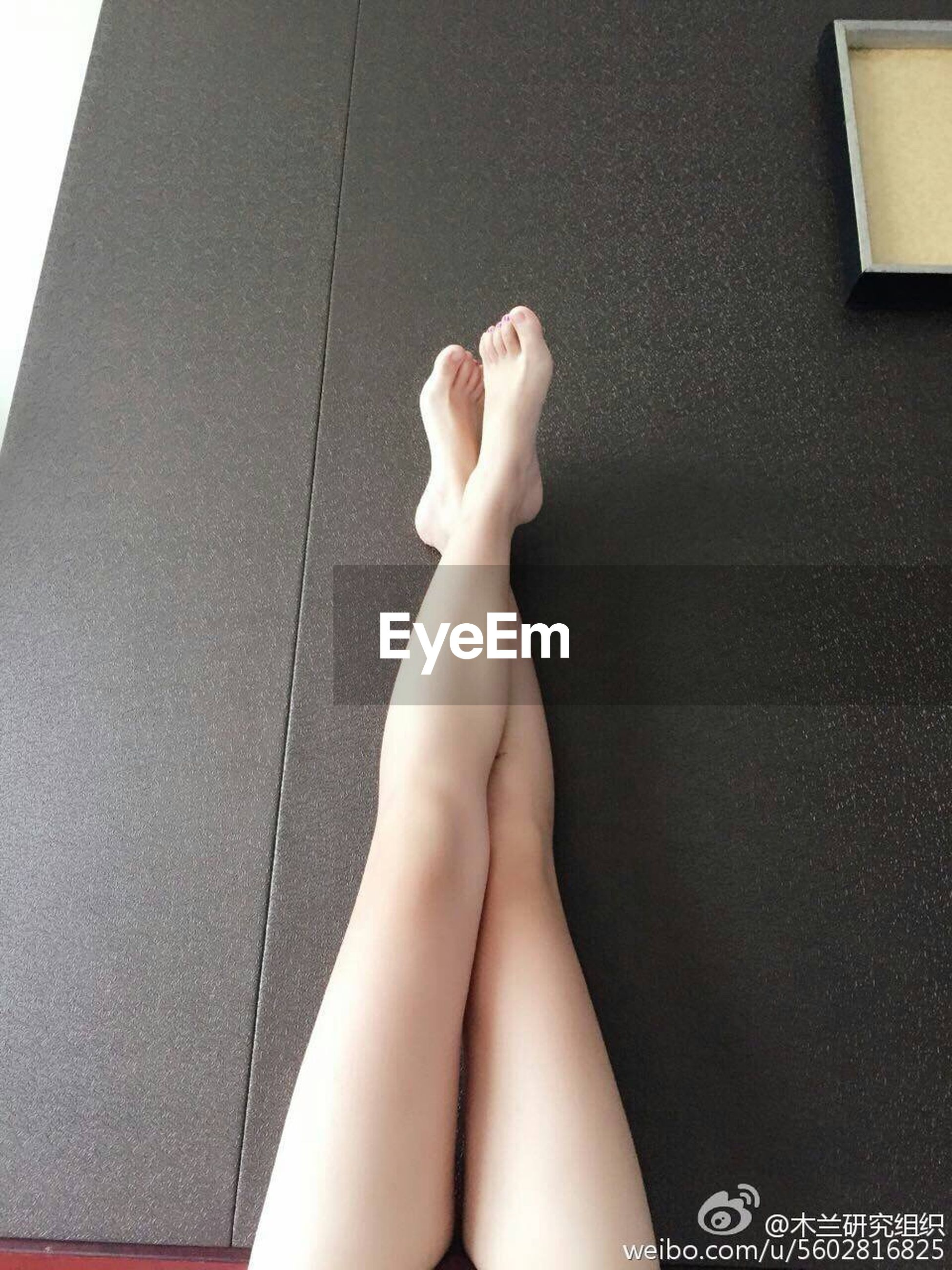 low section, person, personal perspective, indoors, lifestyles, part of, human foot, sensuality, barefoot, leisure activity, relaxation, cropped, femininity, wall - building feature, one woman only