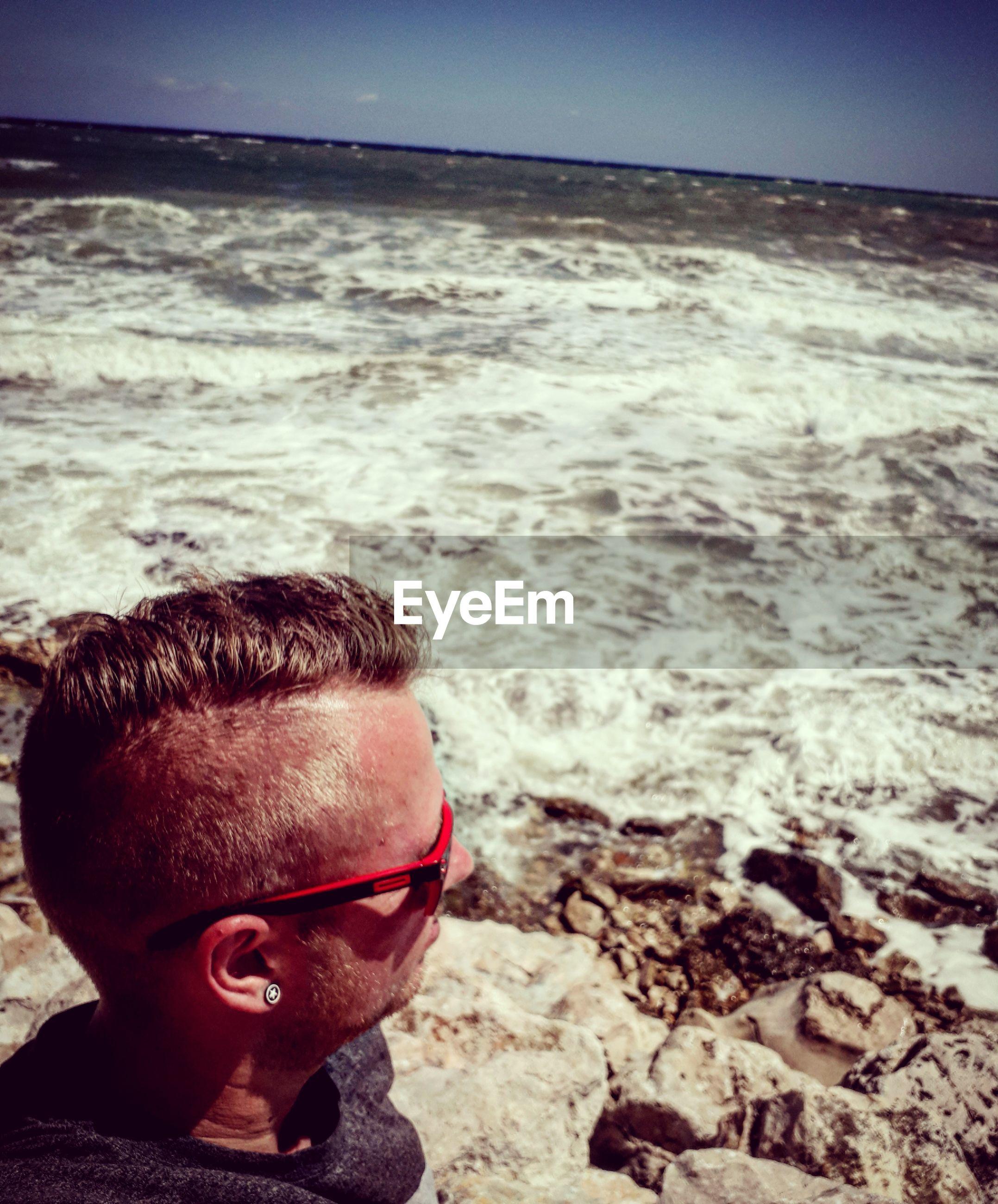 High angle view of man looking at sea