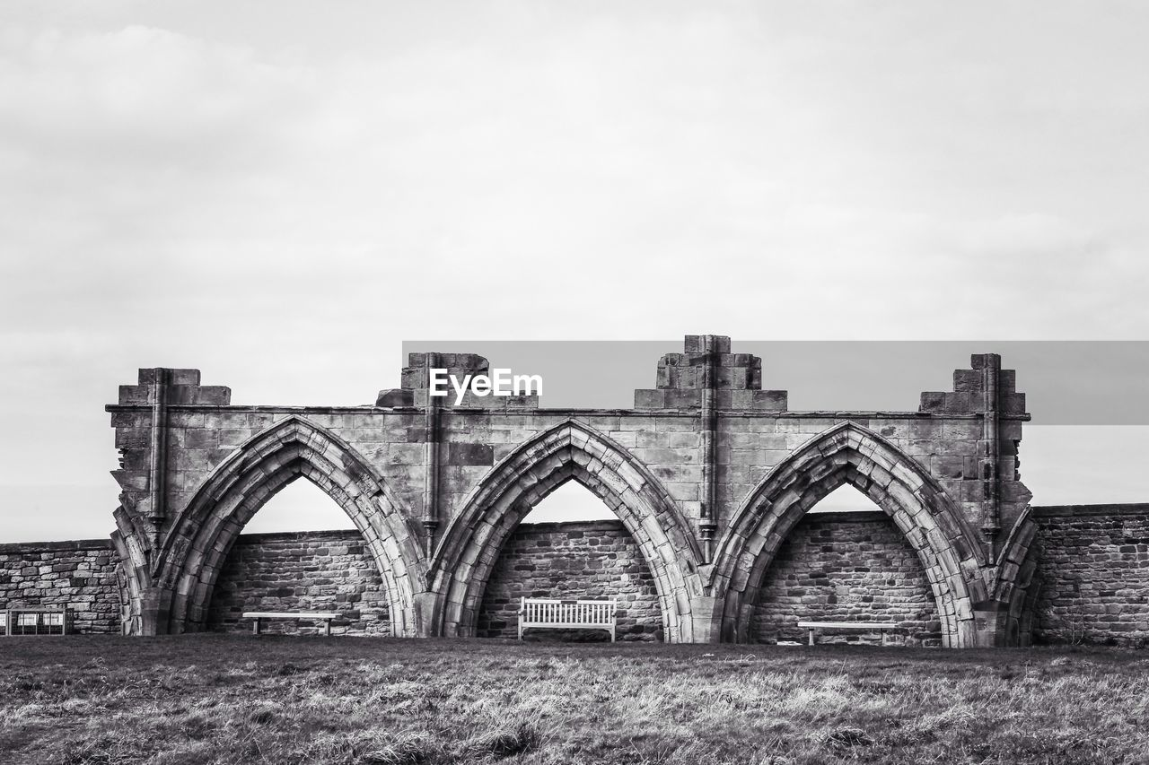 Benches Under Arches Of Ruined Building
