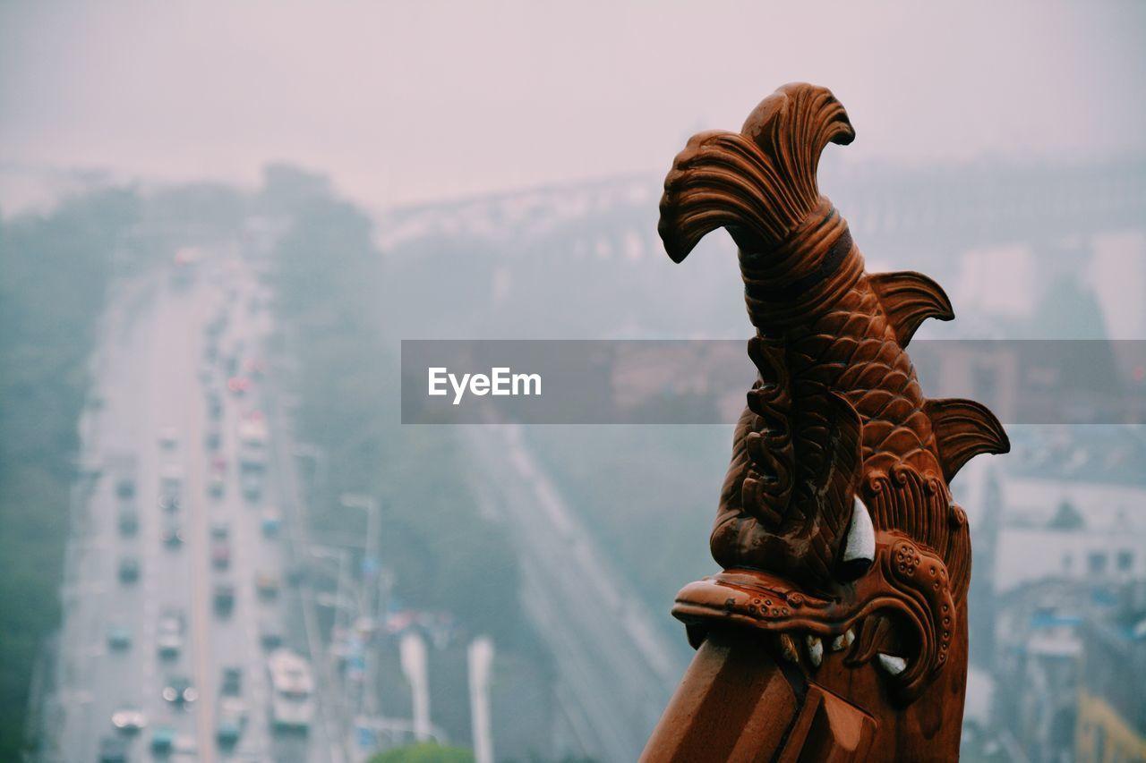 Cropped Image Of Bridge By Street Against Sky