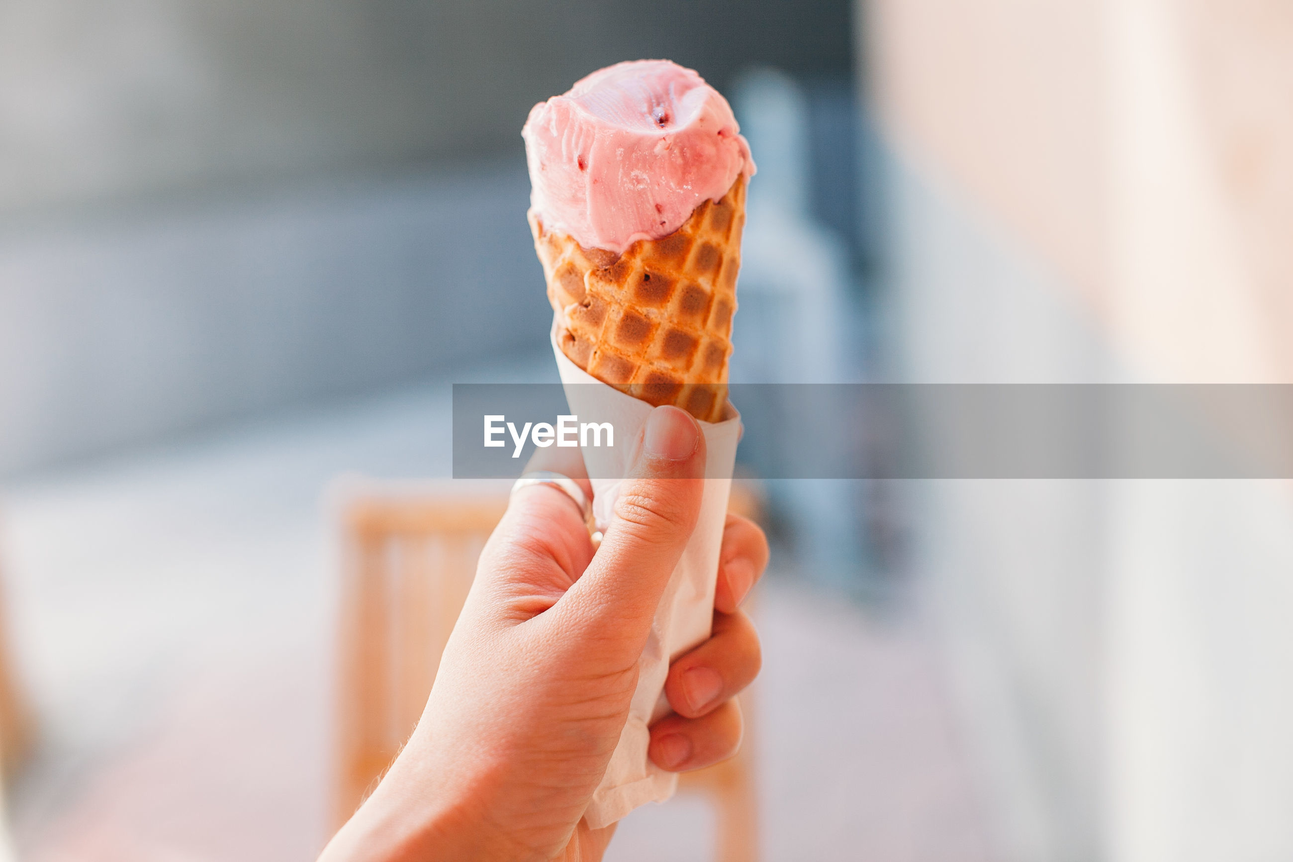 Cropped image of ice cream cone in hand