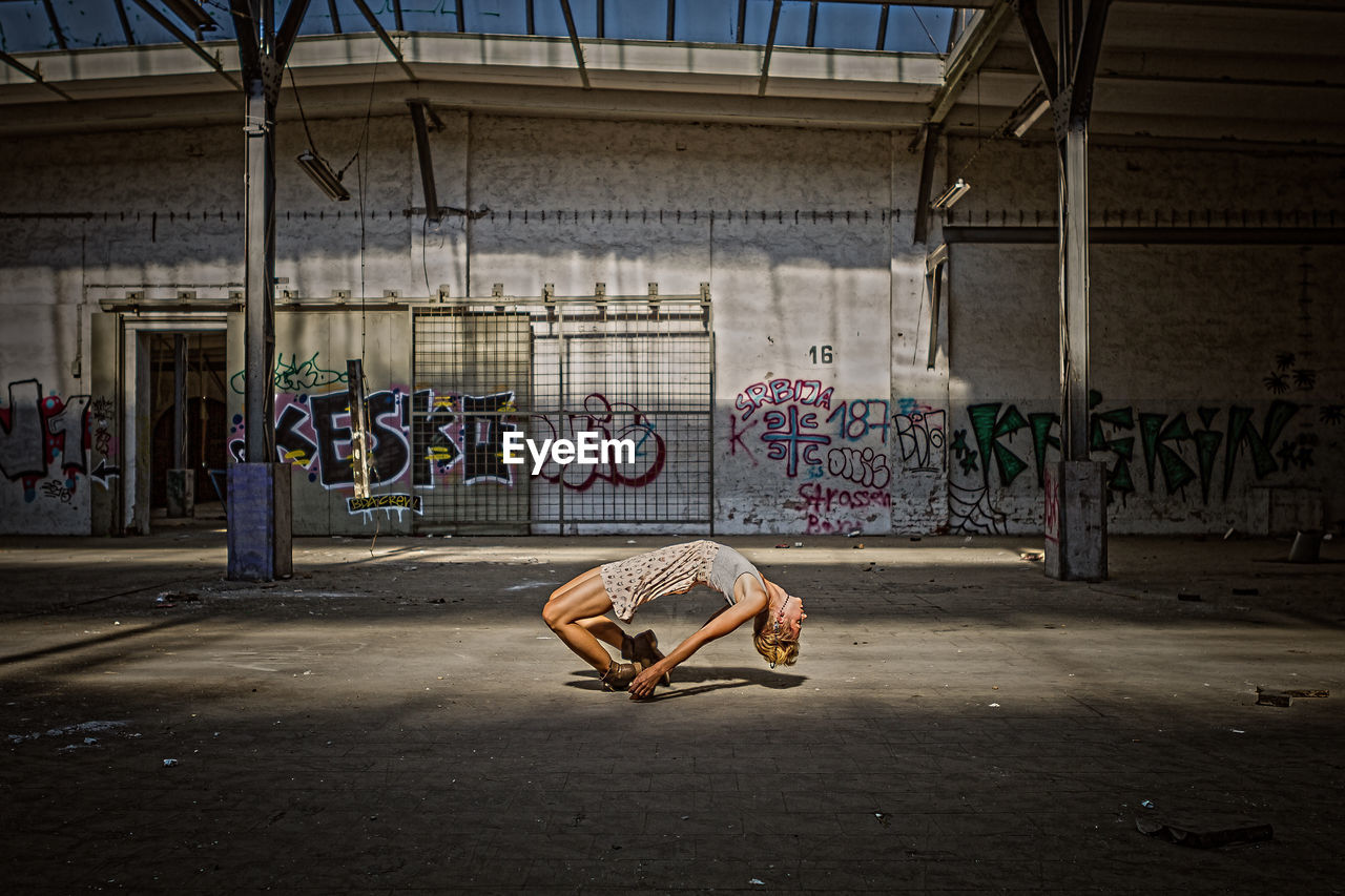 graffiti, real people, men, indoors, built structure, architecture, full length, challenge, day, one person, sportsman, adult, people