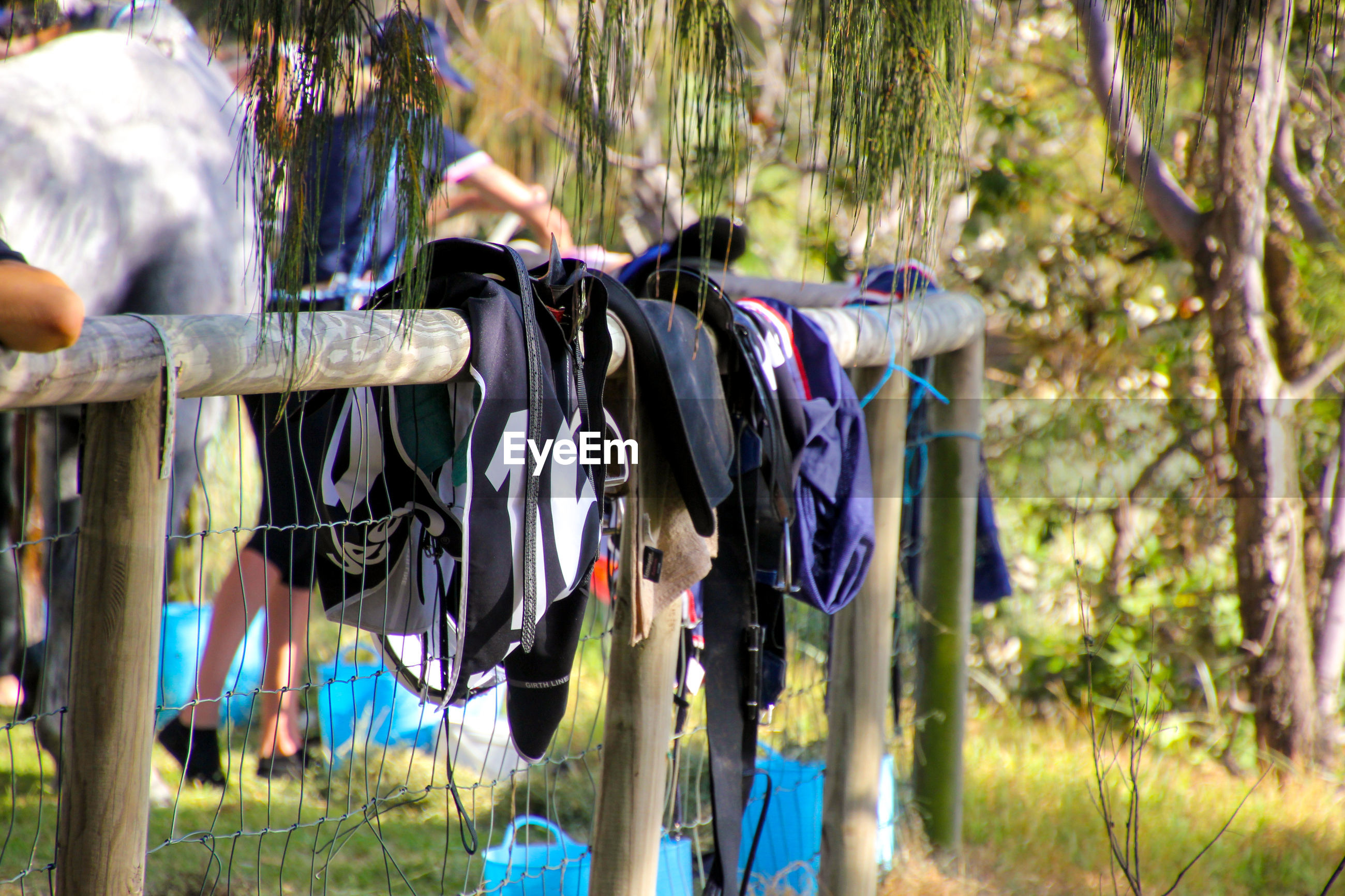 Close-up of clothes drying on railing