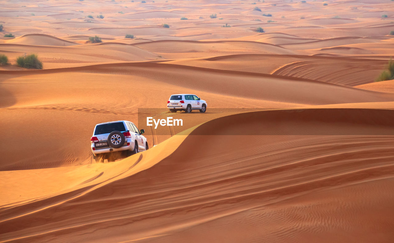 High Angle View Of Off-Road Vehicles On Sand Dunes