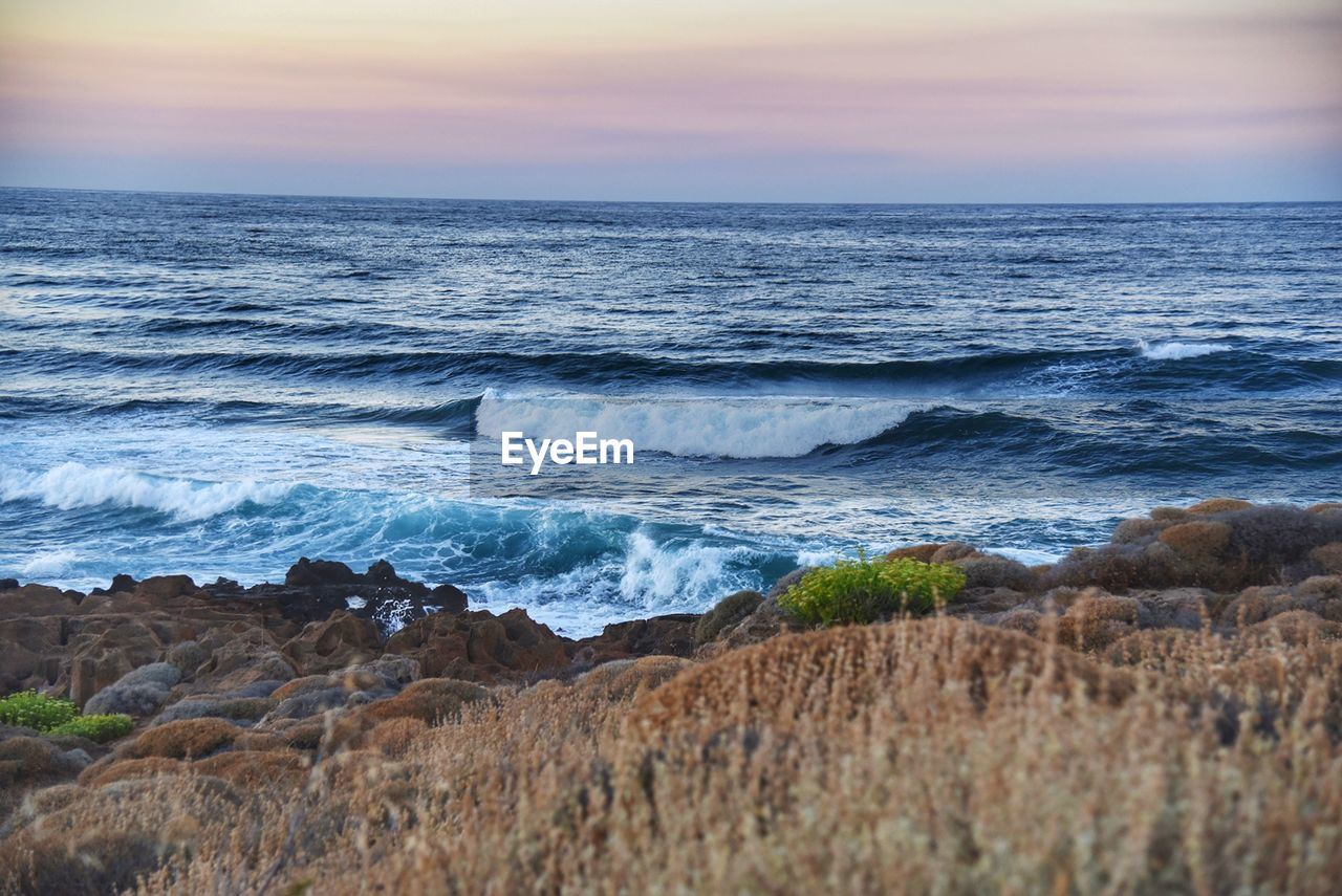 sea, horizon over water, nature, beauty in nature, sunset, scenics, water, wave, beach, tranquil scene, sky, tranquility, no people, outdoors, day