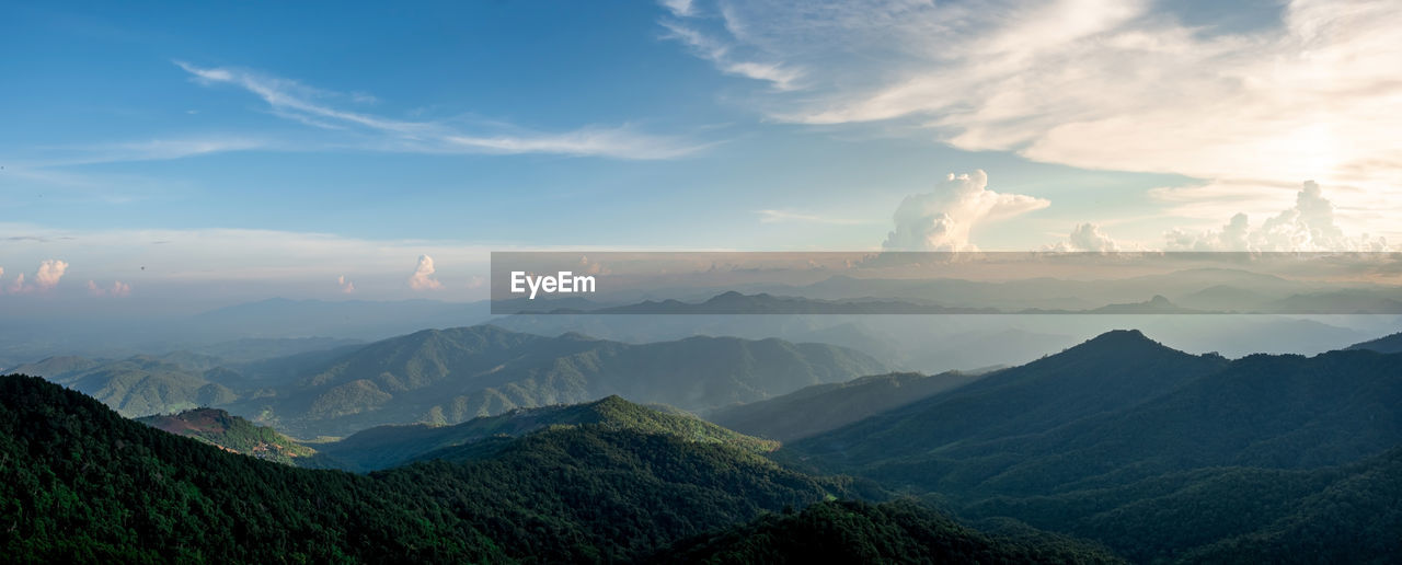 Panorama of mountain views, smooth greenery. natural atmosphere evening light bright clouds and sky.