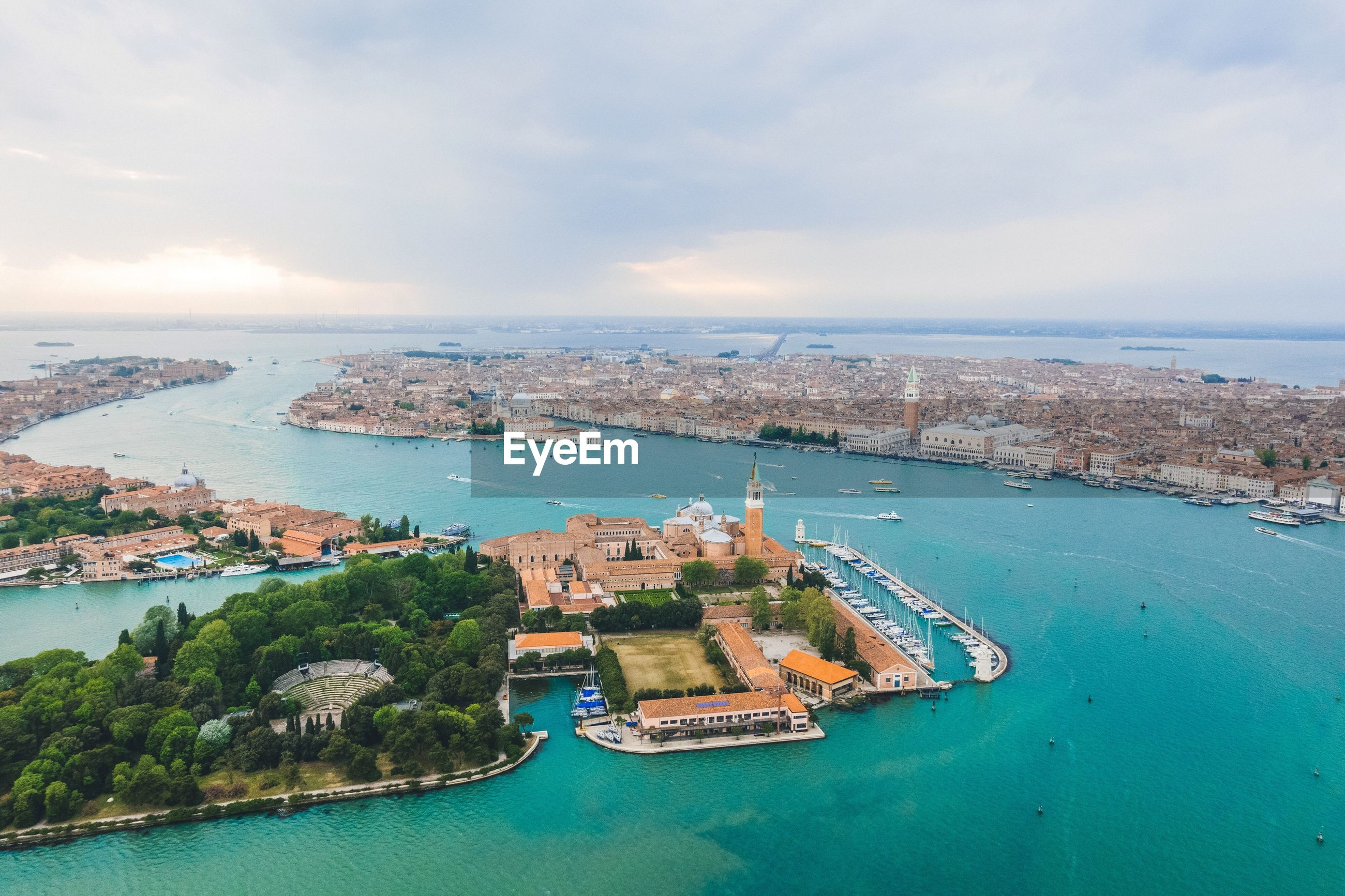 Aerial view of city and grand canal against sky