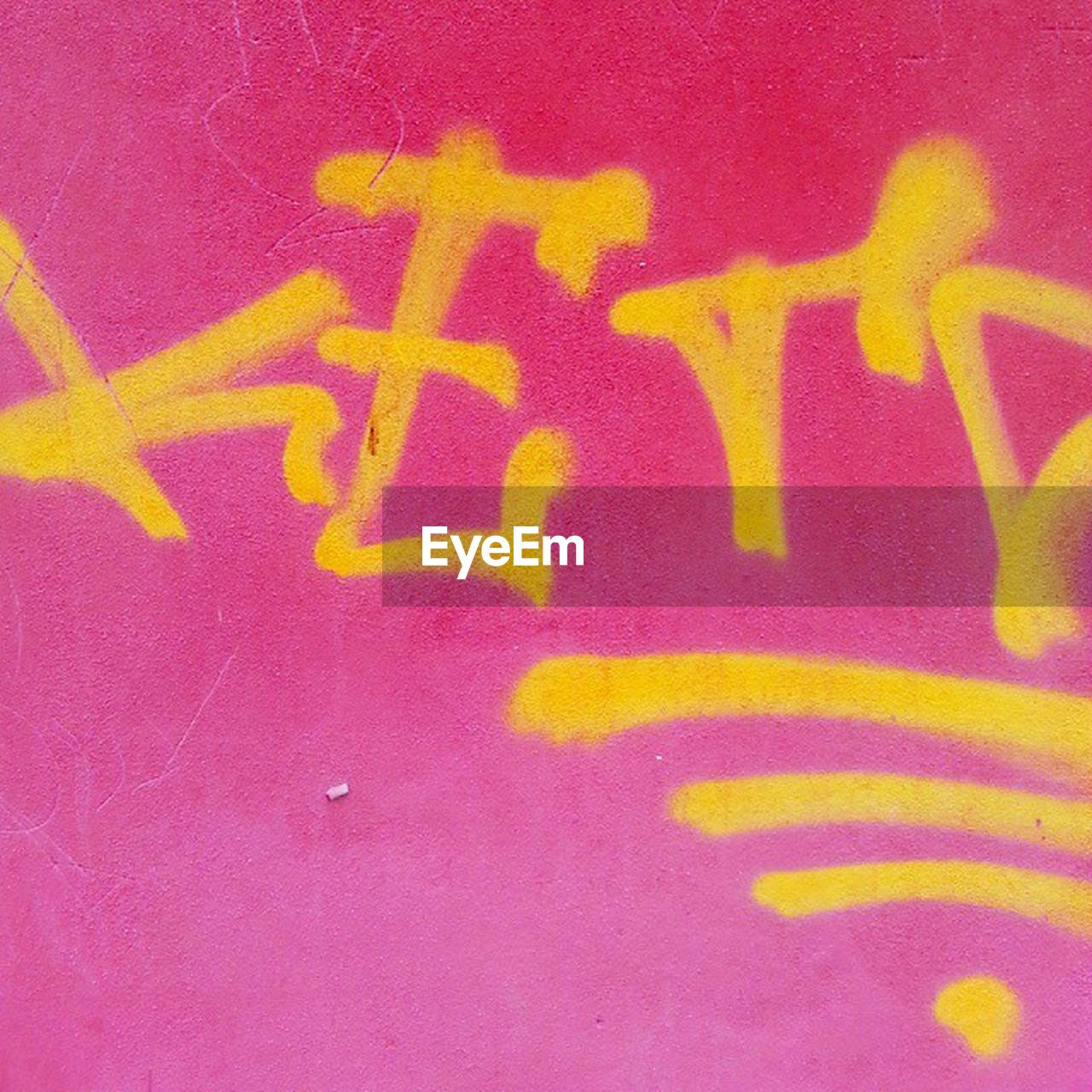 text, yellow, communication, no people, paint, painted image, outdoors, close-up, day, ink