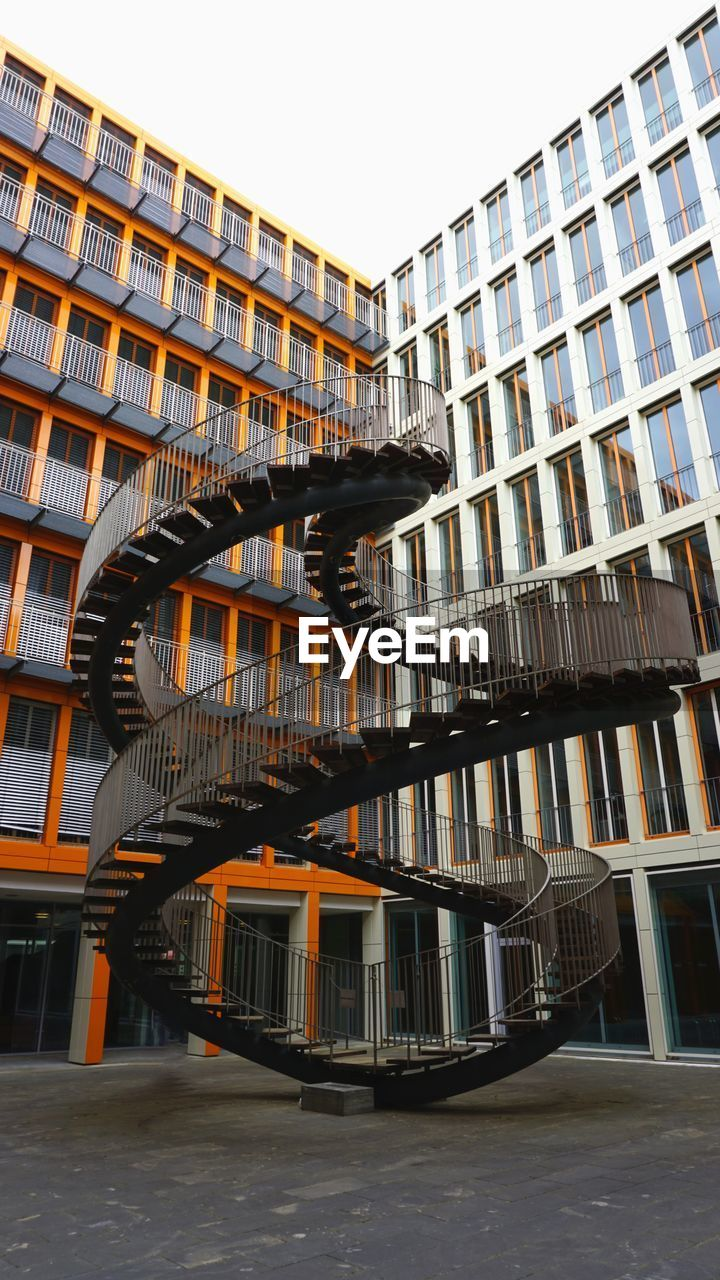 architecture, building exterior, built structure, building, city, no people, day, residential district, modern, low angle view, sky, outdoors, window, nature, staircase, railing, apartment, office building exterior, full length, clear sky