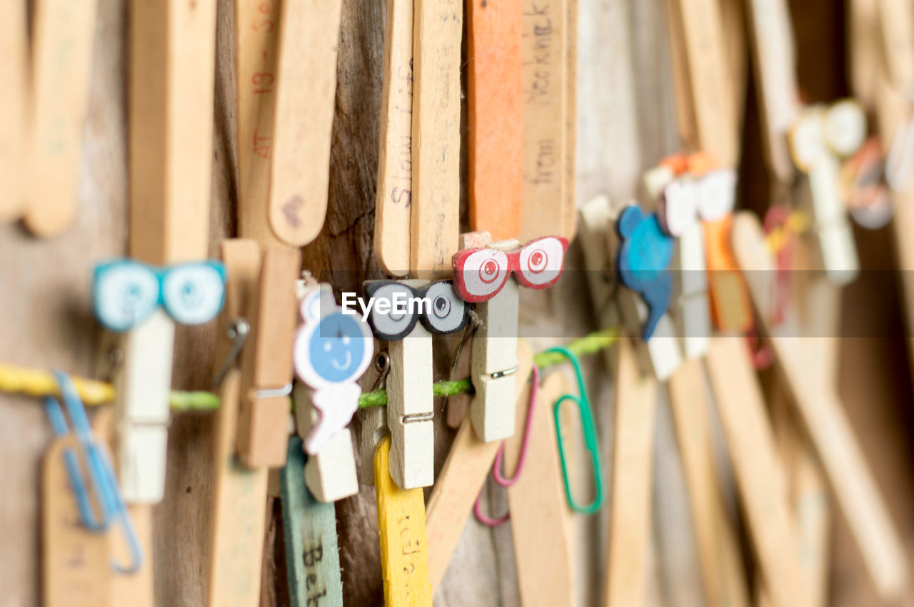Close-Up Of Multi Colored Wooden Clothespins