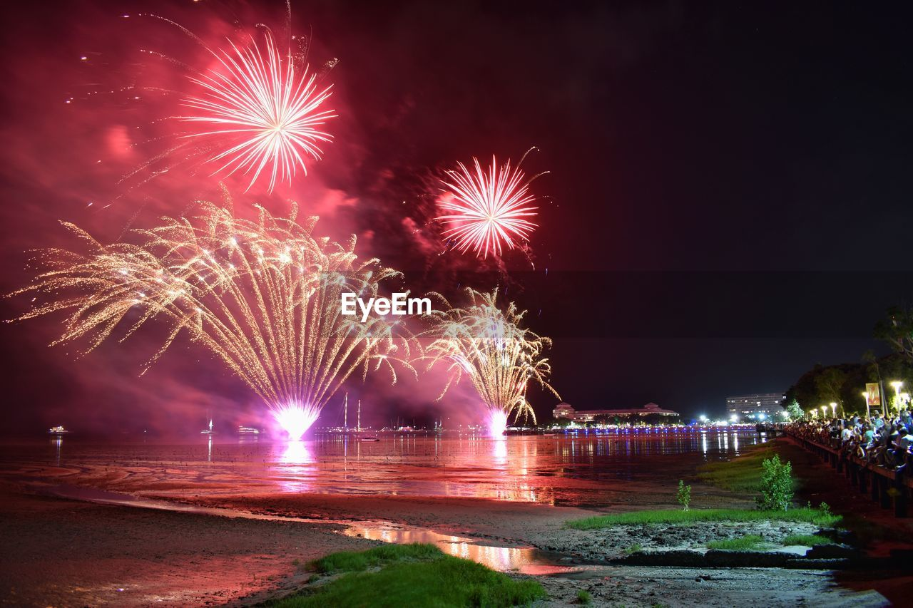 night, firework, illuminated, motion, firework display, long exposure, celebration, arts culture and entertainment, exploding, water, event, glowing, sky, blurred motion, firework - man made object, nature, architecture, no people, river, light, sparks, outdoors