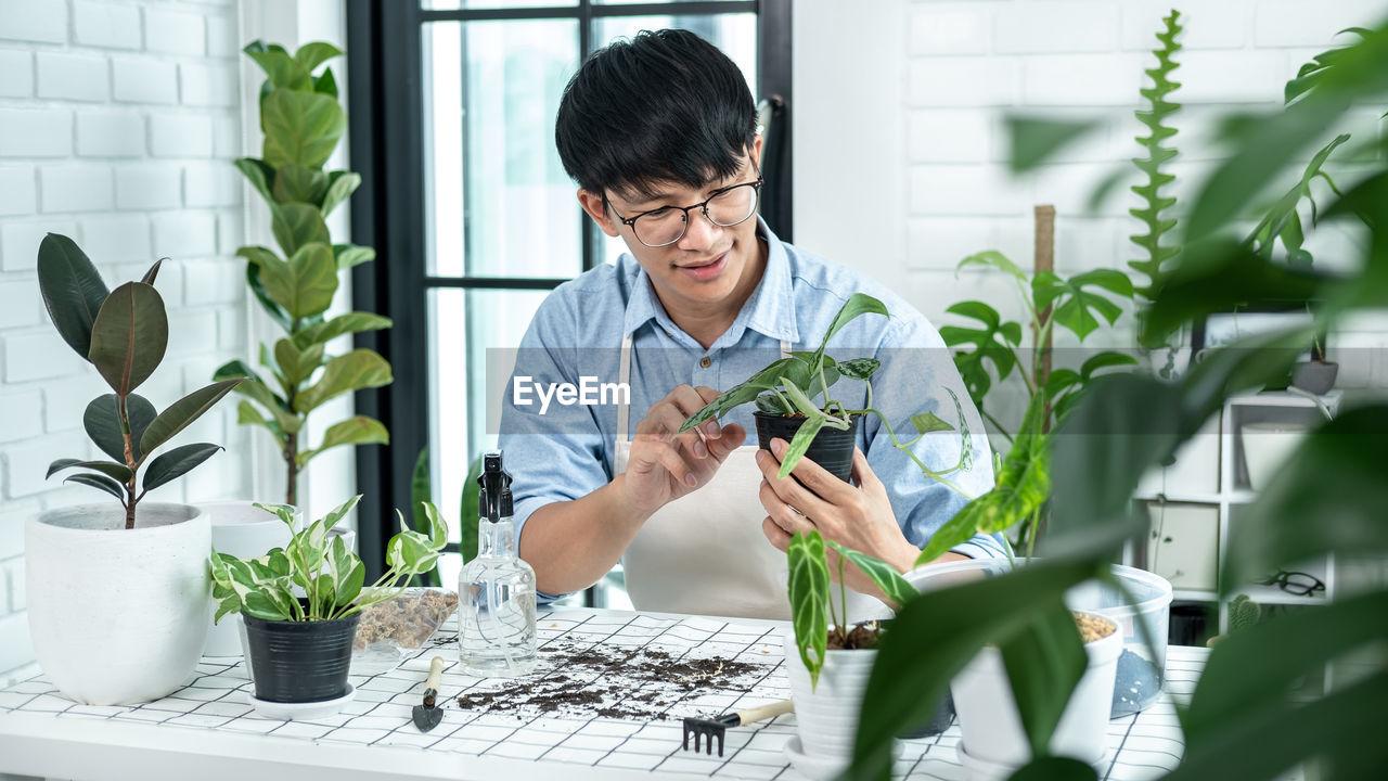 Man planting at home