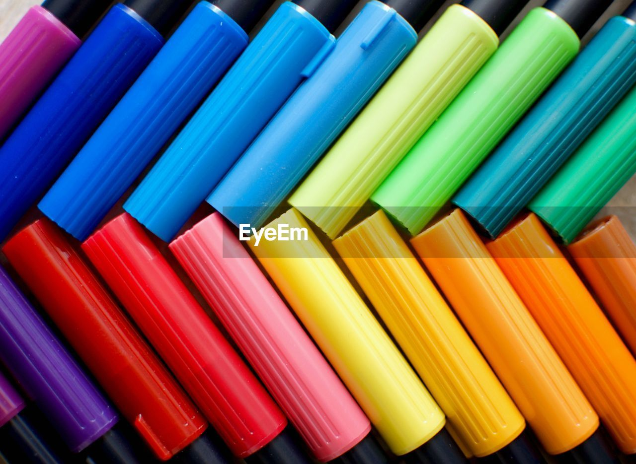 multi colored, choice, variation, side by side, large group of objects, indoors, close-up, still life, arrangement, no people, full frame, writing instrument, pencil, in a row, backgrounds, vibrant color, high angle view, art and craft, art and craft equipment, creativity, order, colored pencil, variety