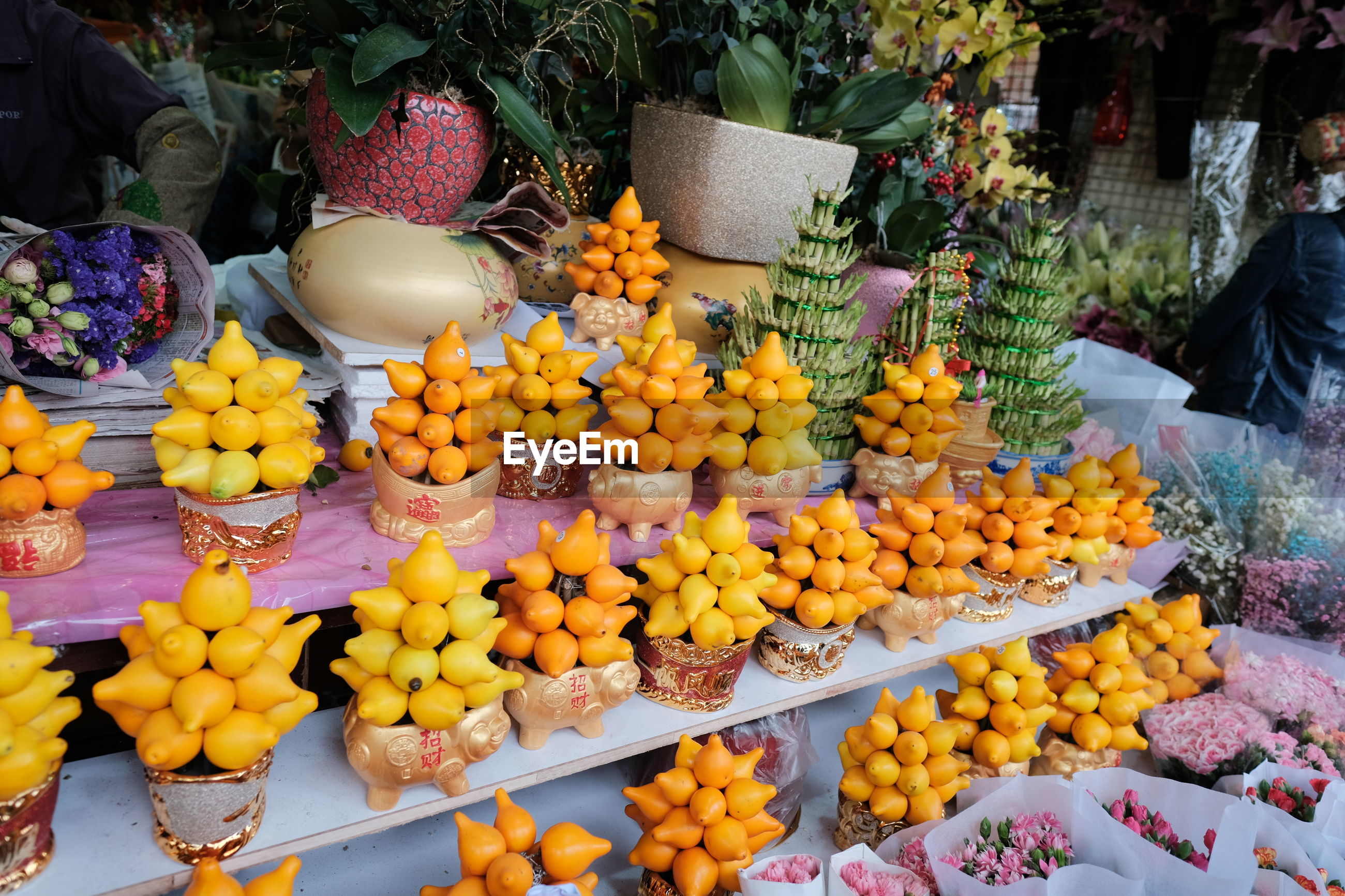 VARIOUS FRUITS FOR SALE IN MARKET STALL