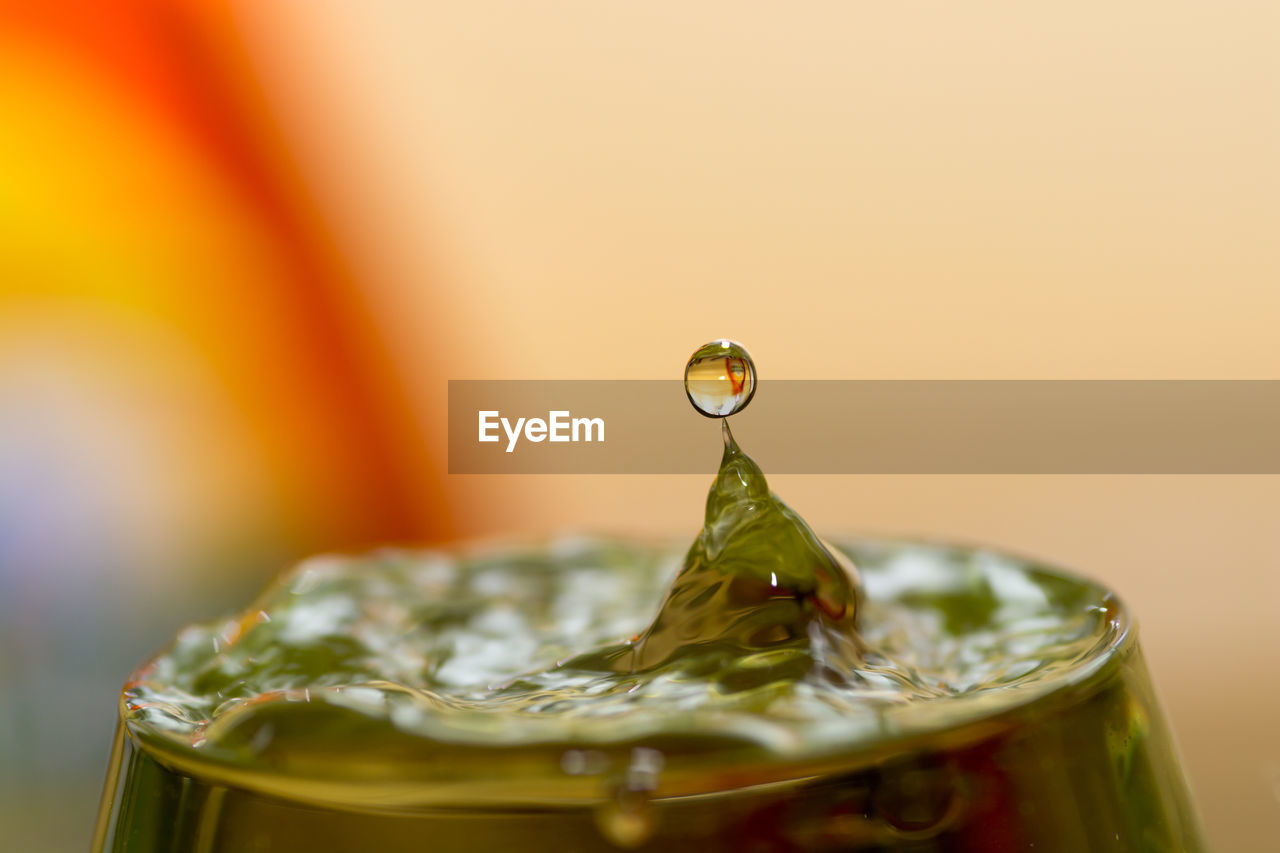 Close-Up Of Water Drop Falling On Glass
