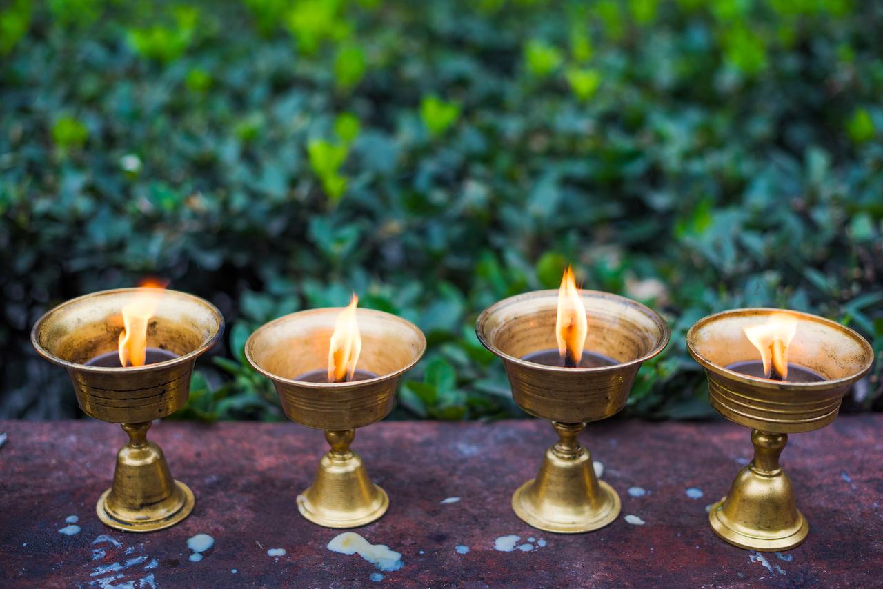Close-Up Of Illuminated Diyas