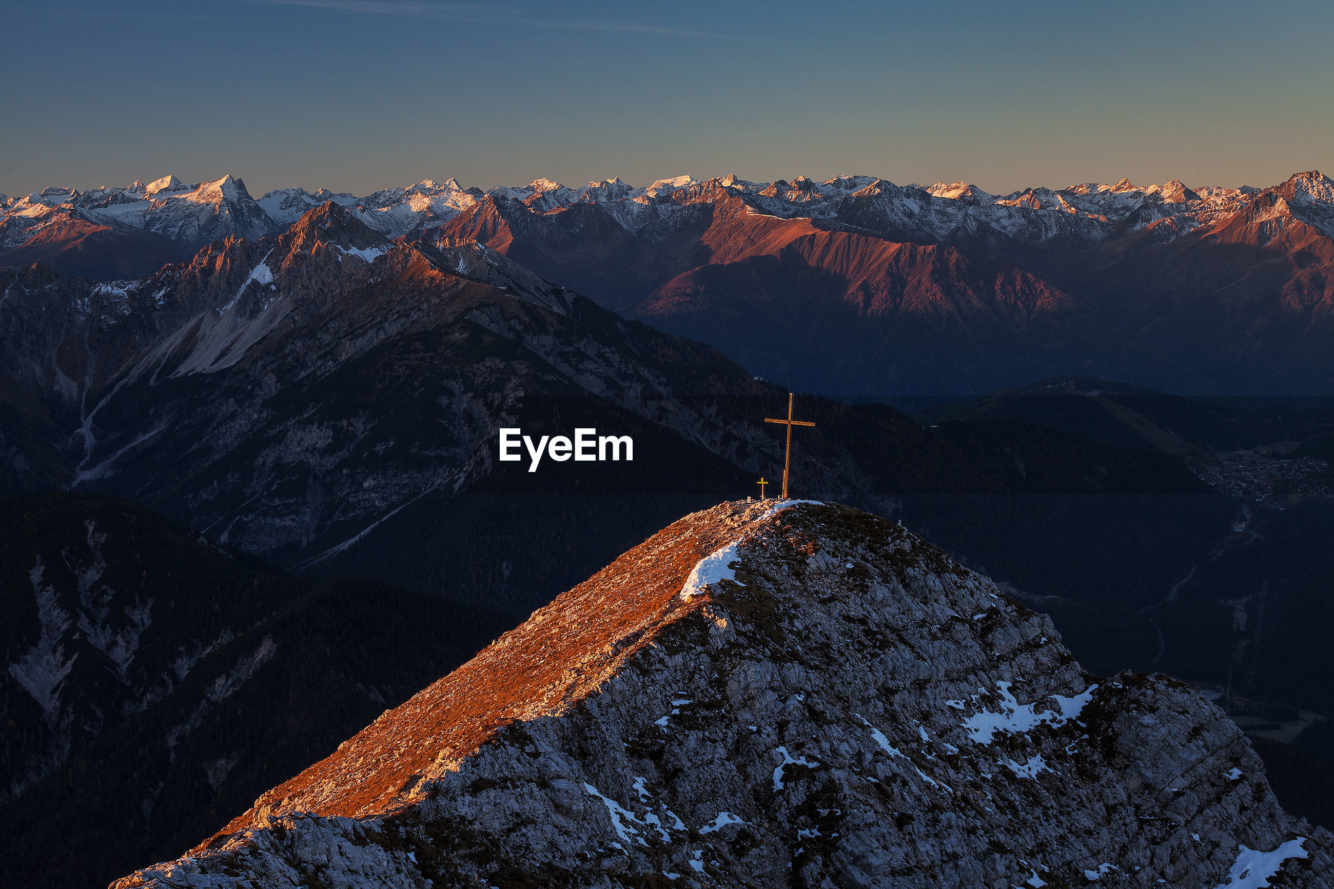 Aerial view of cross on mountain against sky
