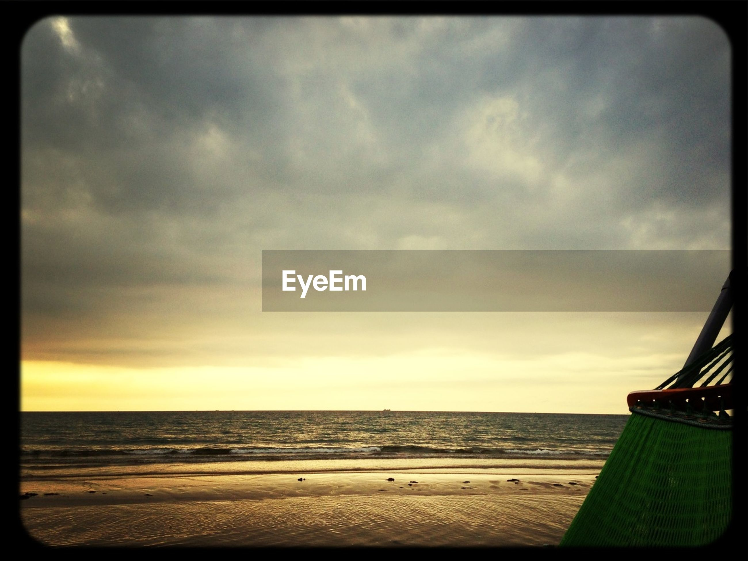 sea, horizon over water, beach, sky, transfer print, water, shore, scenics, auto post production filter, tranquility, tranquil scene, cloud - sky, sand, beauty in nature, nature, cloud, cloudy, idyllic, outdoors, coastline