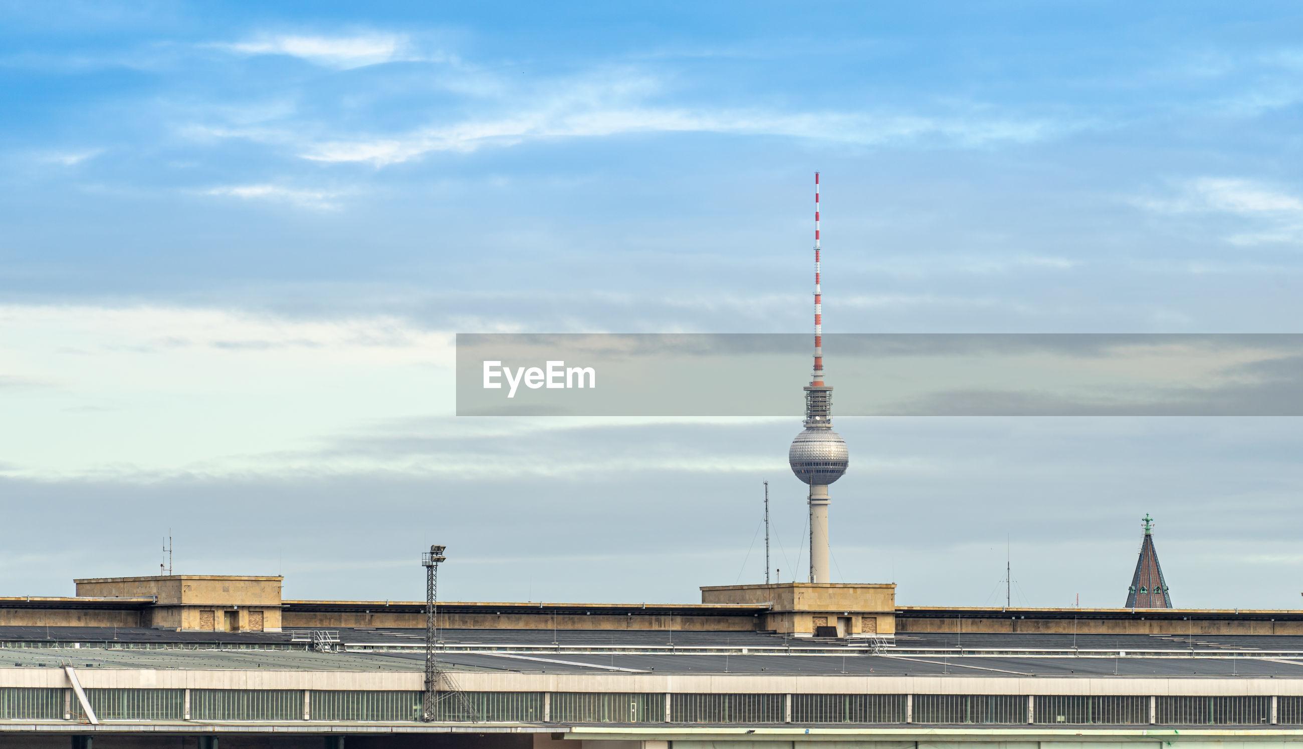 Fernsehturm in city against sky