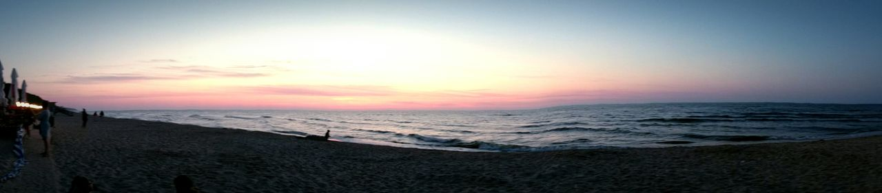 Panoramic view of seascape against sky during sunset