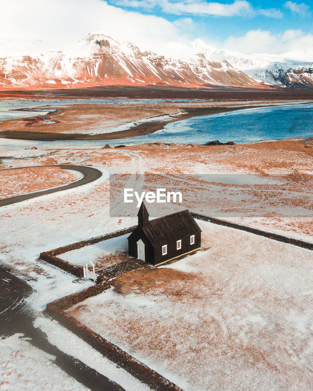 High Angle View Of House On Field Against Mountains During Winter