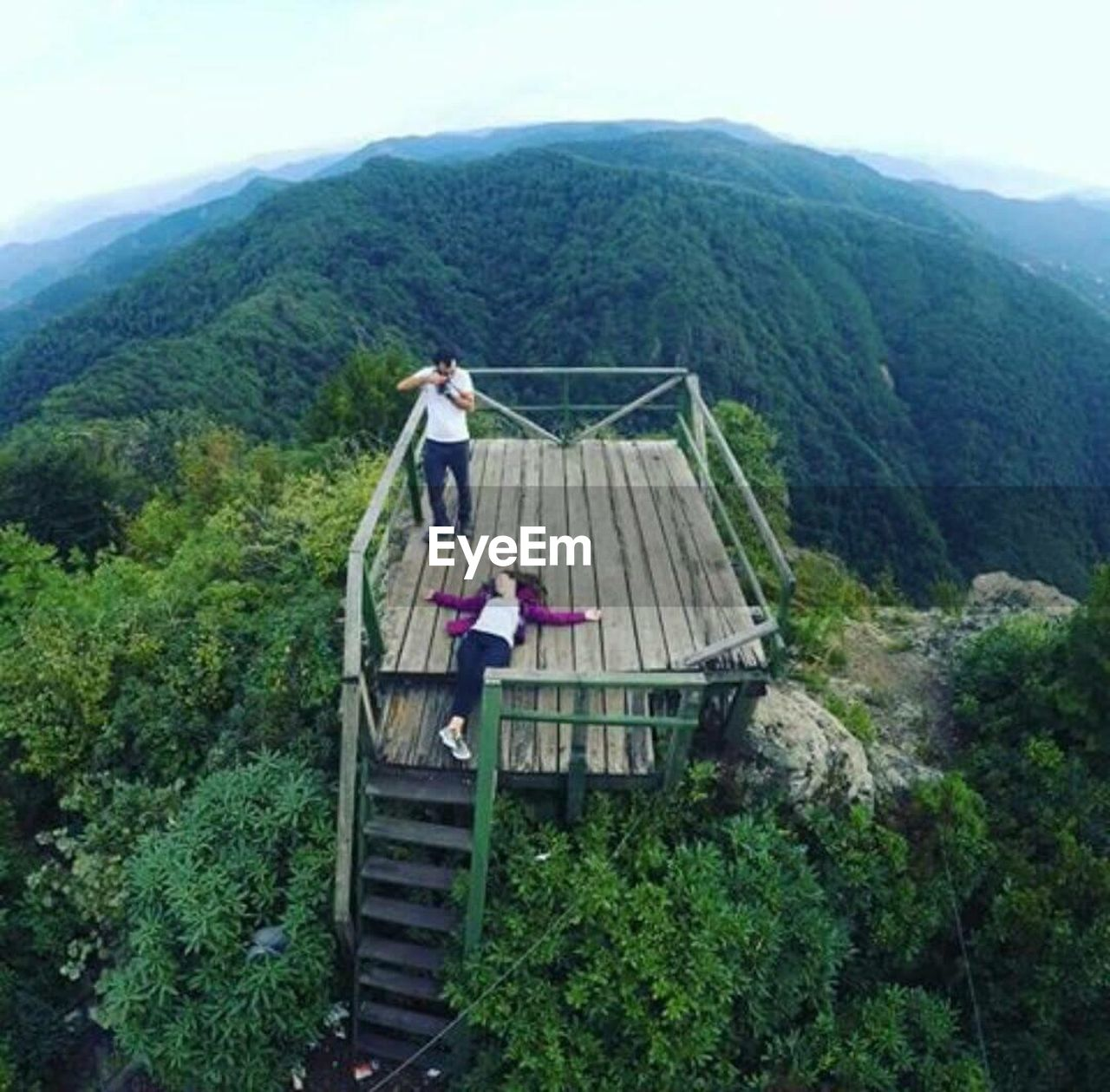 mountain, tree, one person, steps and staircases, day, full length, adults only, outdoors, young adult, nature, sky, people, one man only, adult, climbing, mountain range, standing, only men, one young man only, men, architecture