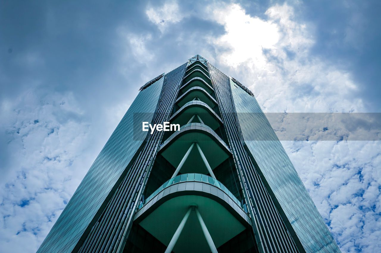 low angle view, cloud - sky, sky, architecture, built structure, building exterior, building, modern, city, tall - high, no people, day, nature, office building exterior, tower, skyscraper, outdoors, office, travel destinations, directly below, financial district