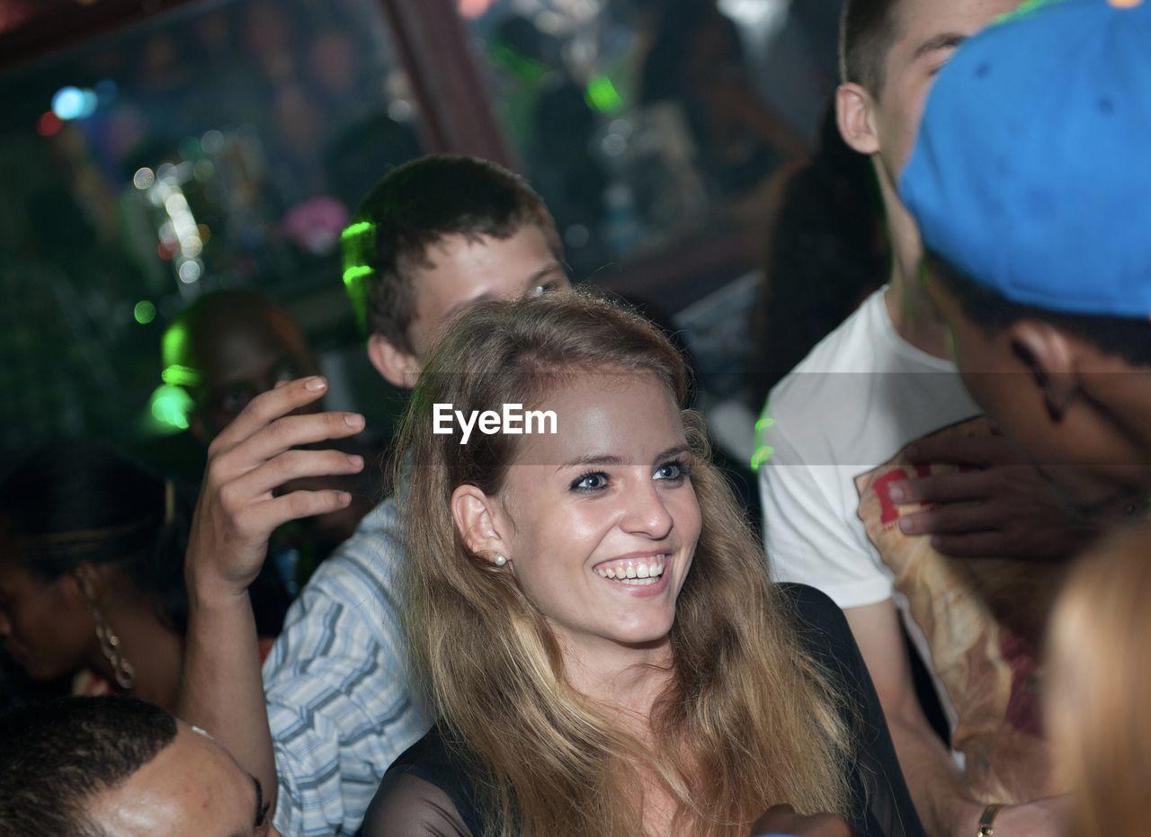 Young Woman And Men Enjoying At Party