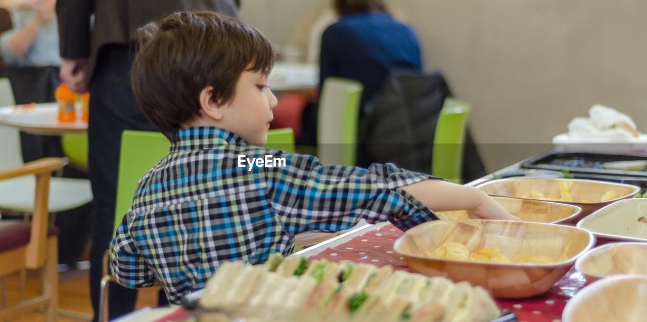 Boy having food at restaurant