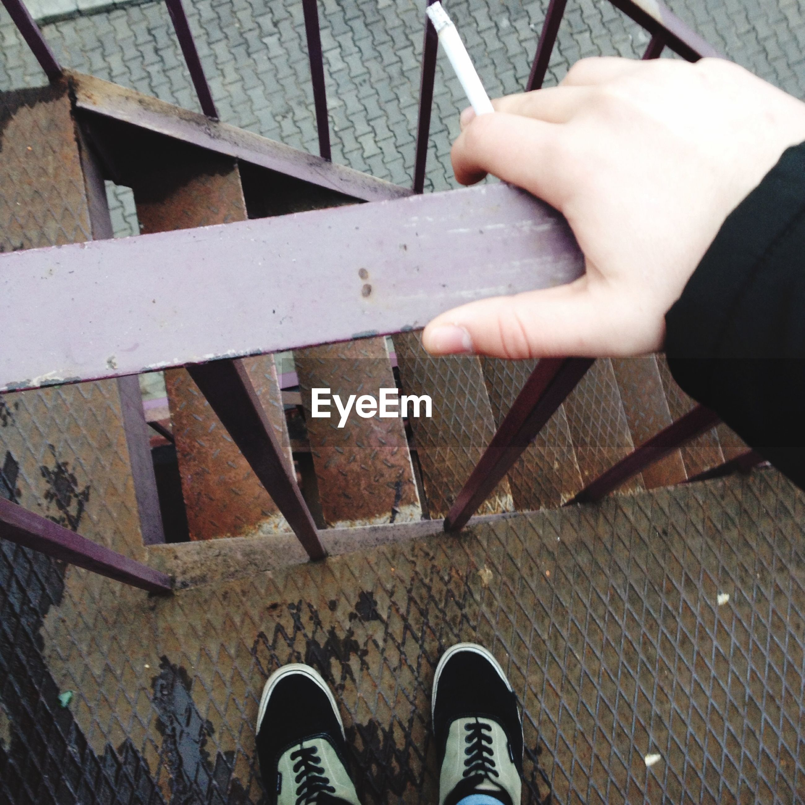low section, person, shoe, personal perspective, lifestyles, standing, high angle view, part of, men, human foot, unrecognizable person, leisure activity, wood - material, footwear, cropped, metal