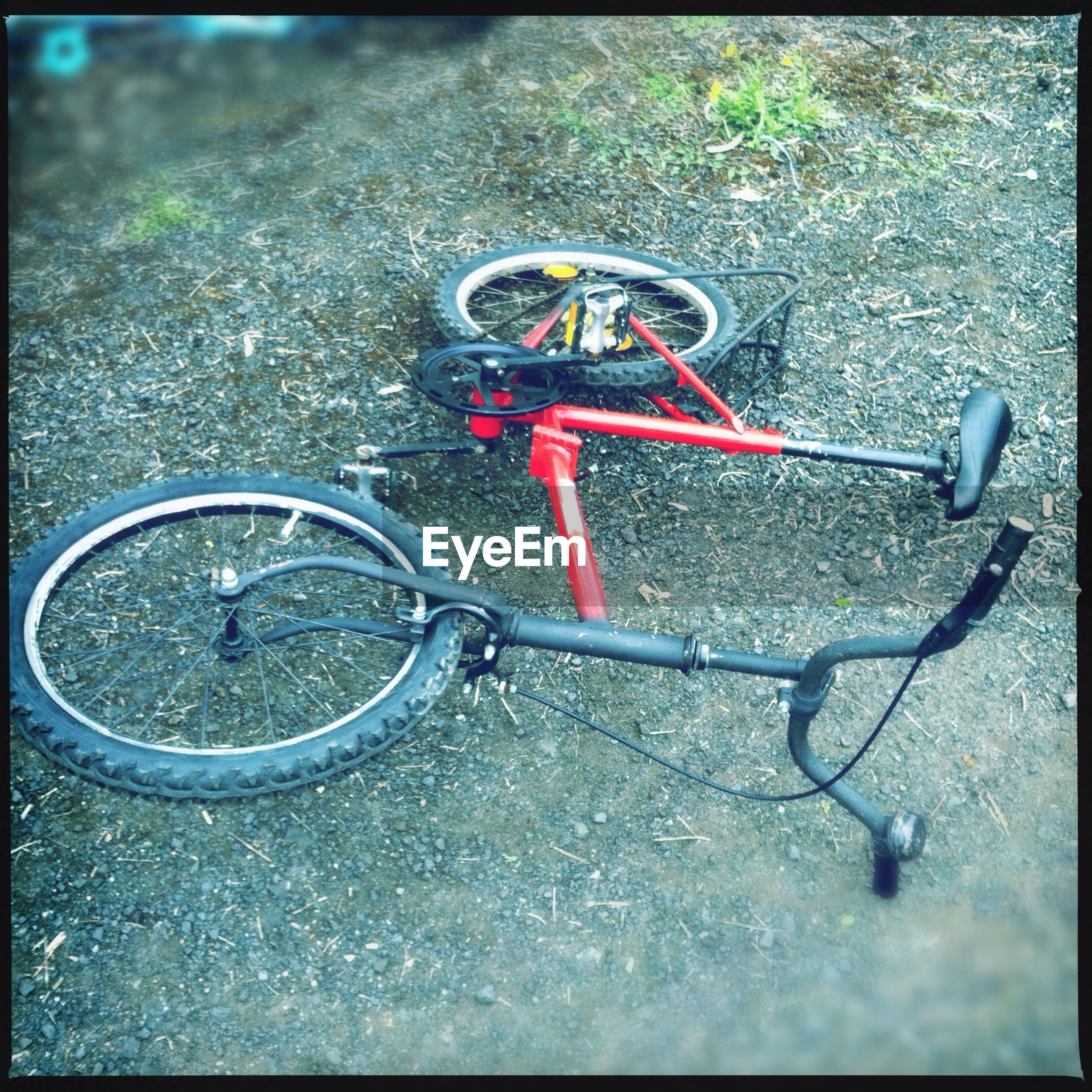 transfer print, bicycle, transportation, auto post production filter, mode of transport, land vehicle, stationary, street, high angle view, parked, day, close-up, no people, parking, outdoors, road, metal, wheel, part of, safety