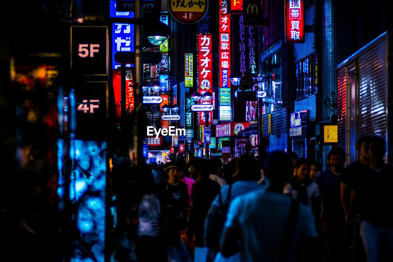 Crowd At Illuminated Street Market During Night
