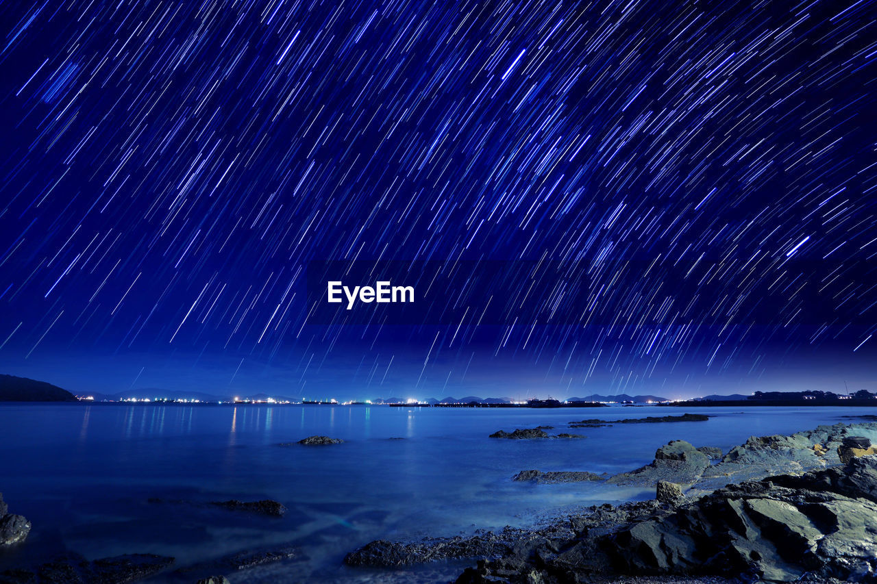 water, scenics - nature, night, beauty in nature, star - space, sky, sea, astronomy, space, long exposure, tranquil scene, tranquility, nature, rock, galaxy, star, no people, star field, rock - object, horizon over water, outdoors, milky way