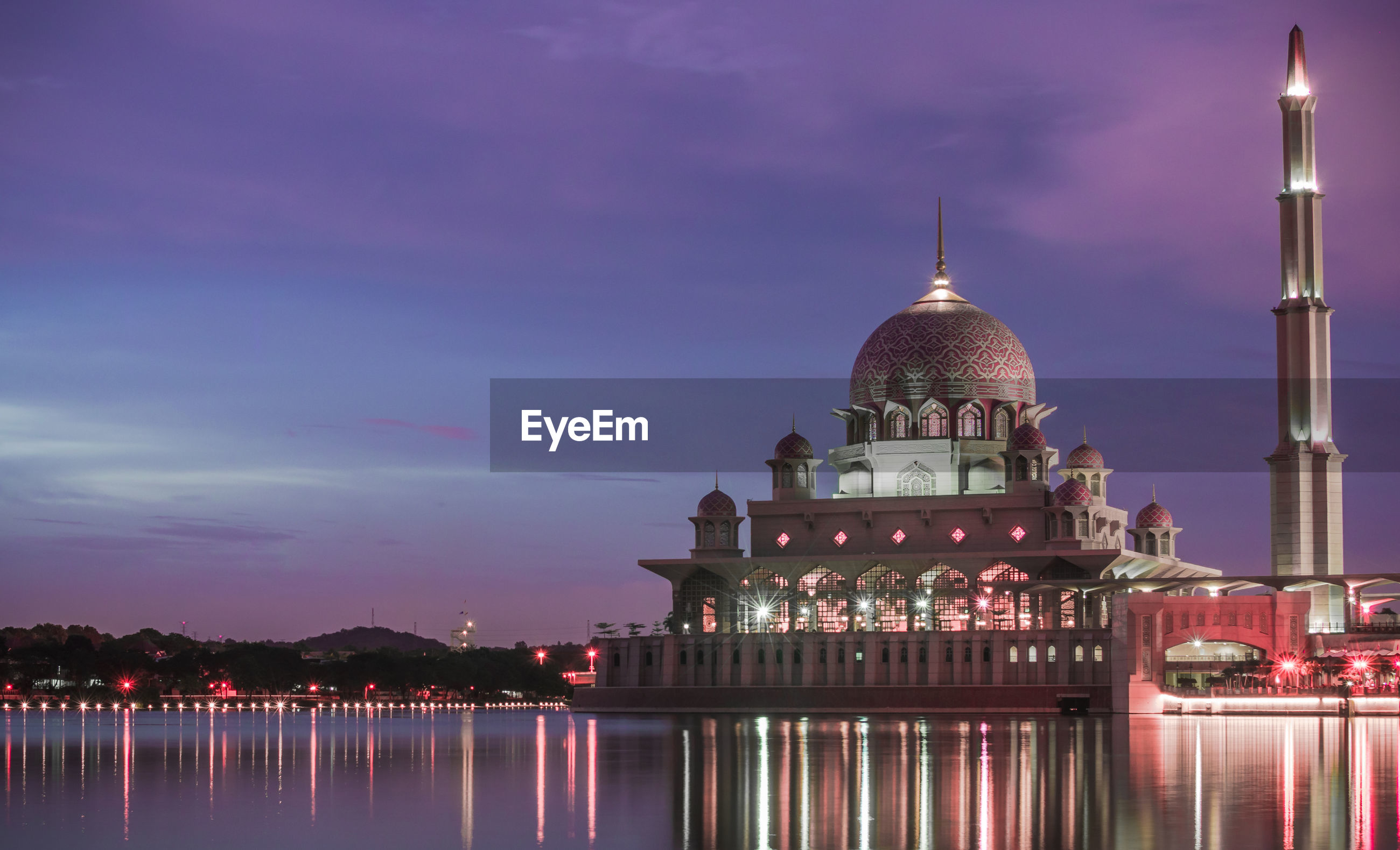 Putra mosque in lake against sky at dusk