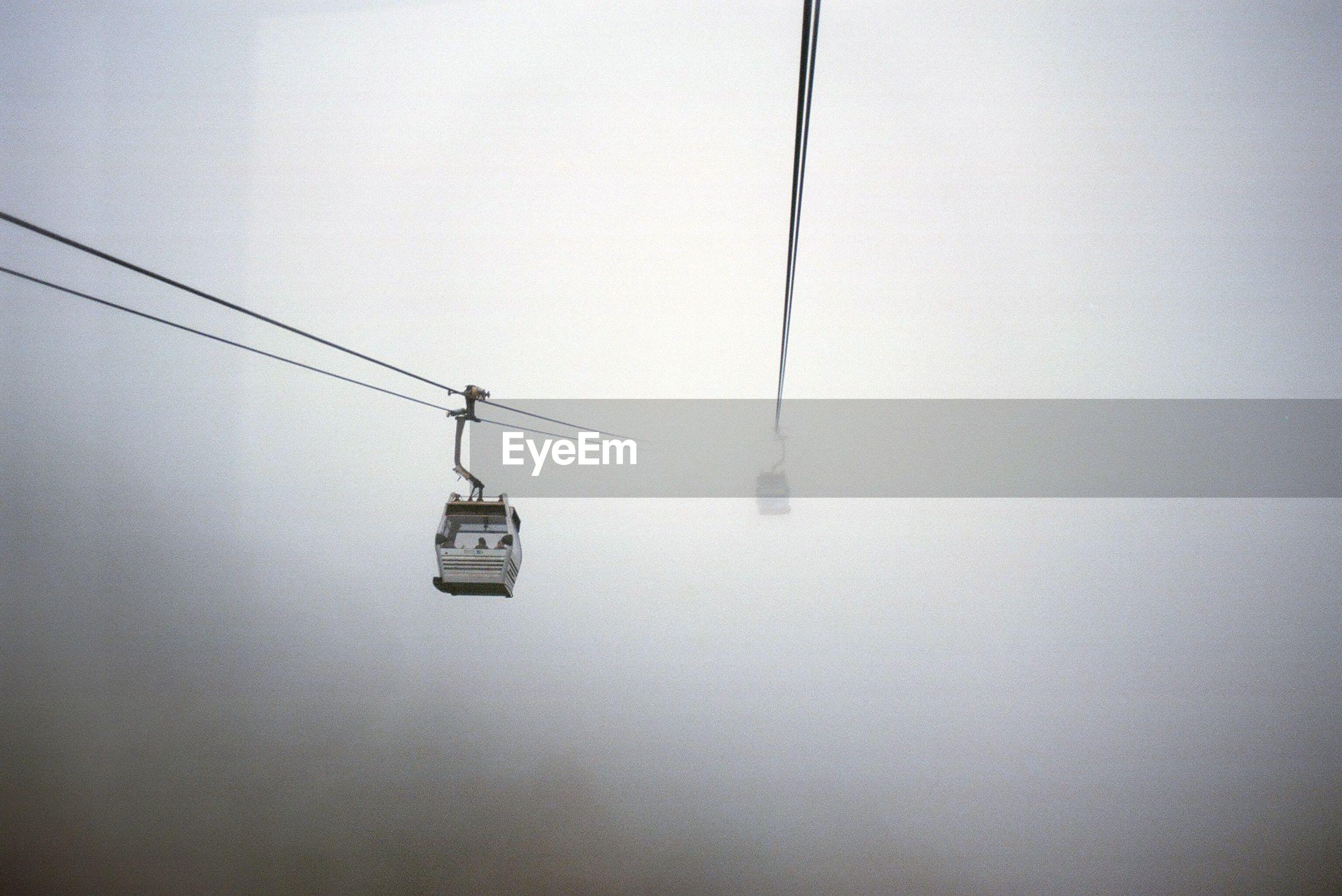 Overhead cable car against sky