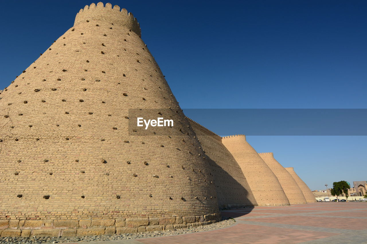 architecture, history, the past, sky, clear sky, built structure, travel destinations, tourism, nature, travel, day, ancient, no people, building exterior, ancient civilization, blue, low angle view, pyramid, outdoors, archaeology