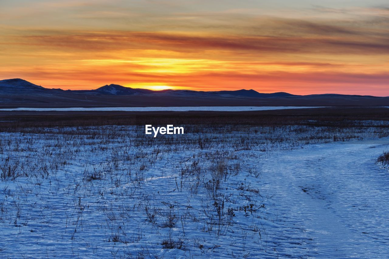 sunset, nature, beauty in nature, scenics, orange color, tranquility, tranquil scene, winter, snow, landscape, cold temperature, sky, outdoors, no people, mountain, day