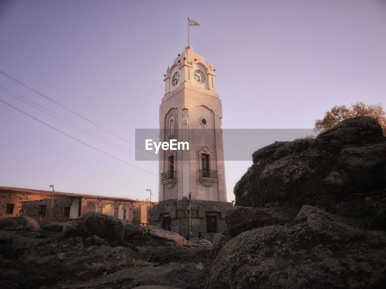 built structure, architecture, building exterior, building, sky, tower, religion, low angle view, belief, spirituality, place of worship, nature, no people, clear sky, rock, rock - object, history, outdoors, spire