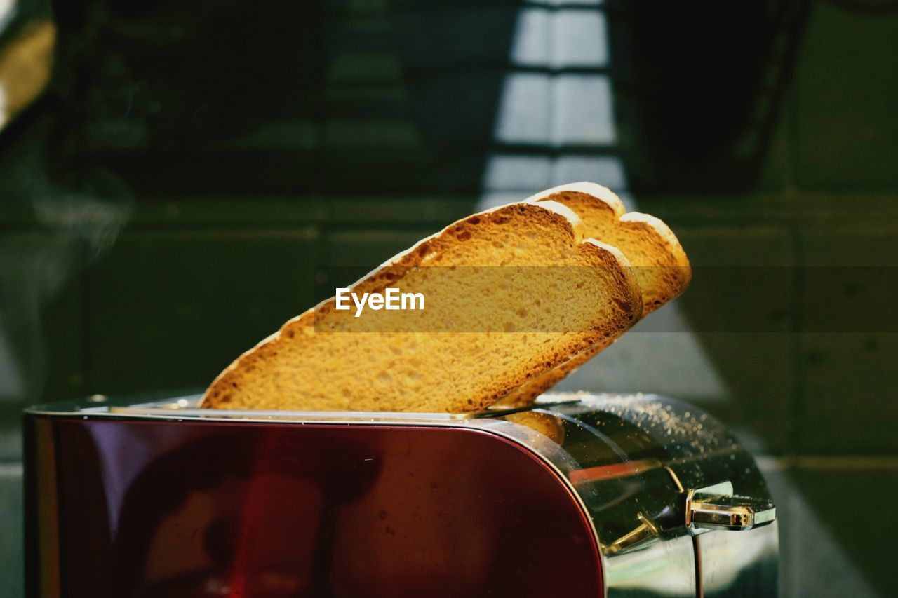 food and drink, food, freshness, bread, close-up, indoors, focus on foreground, appliance, still life, no people, toaster, brown, selective focus, metal, toasted bread, household equipment, baked, meal, wellbeing, container, breakfast