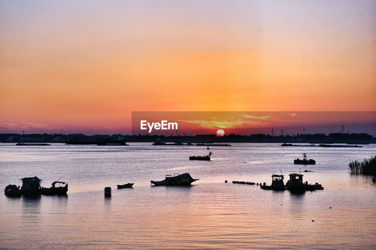 sunset, water, sky, orange color, scenics - nature, beauty in nature, waterfront, cloud - sky, sea, transportation, nautical vessel, silhouette, tranquility, nature, mode of transportation, idyllic, tranquil scene, no people, outdoors, romantic sky