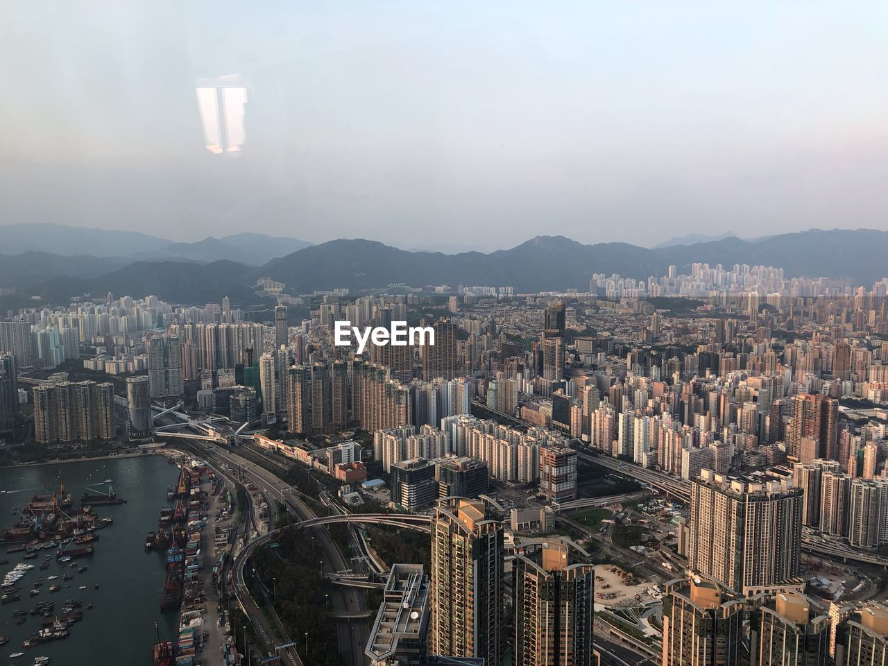city, building exterior, architecture, cityscape, built structure, building, mountain, sky, crowd, skyscraper, nature, office building exterior, modern, tall - high, high angle view, residential district, landscape, crowded, aerial view, urban skyline, mountain range, outdoors, financial district, bay